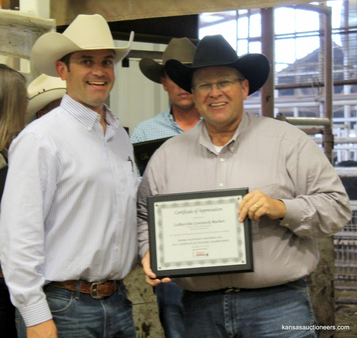 Charly Cummings with Coffeyville Livestock Market co-owner, Jimmy King
